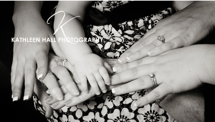 Hands of a 3 generation portrait